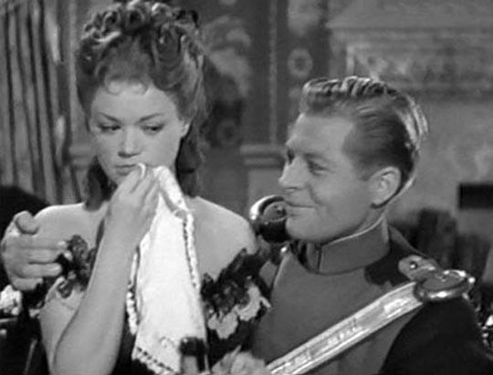 """Elisabeth Rousset (Simone Simon) and """"Fifi"""" (Kurt Kreuger) in Robert Wise's Mdemoiselle Fifi (1944)"""