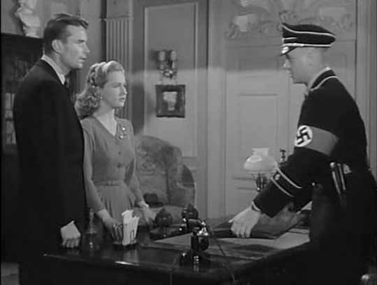 Kent Smith and Bonita Granville object to the Nazis