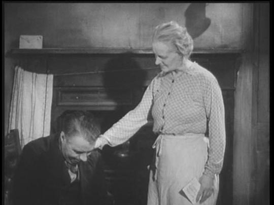 Mr & Mrs Hardcastle (George Carney, Mary Merrall) despairing for the kids' future