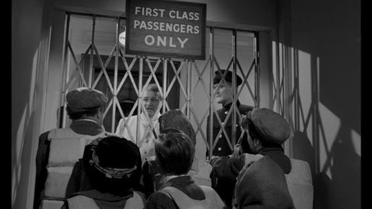 Third-class passengers on the Titanic are forced to remain below decks in order to give first-class passengers time to get to the boats