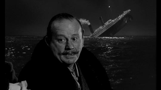 White Star Line chairman J. Bruce Ismay turns away from the sinking Titanic