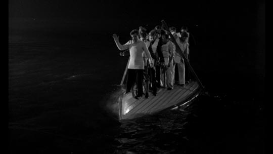 2nd Officer Charles Lightoller guides an upturned lifeboat to safety