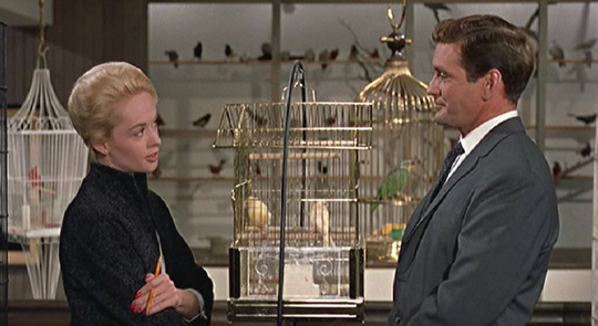 """Rod Taylor and Tippi Hedren """"meet cute"""" in the opening scene of Alfred Hitchcock's The Birds (1963)"""