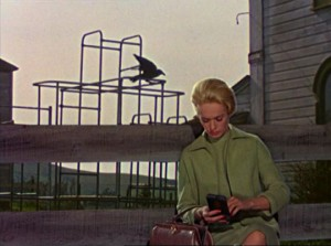 Melanie, although concerned, remains oblivious of the gathering threat in Alfred Hitchcock's The Birds (1963)
