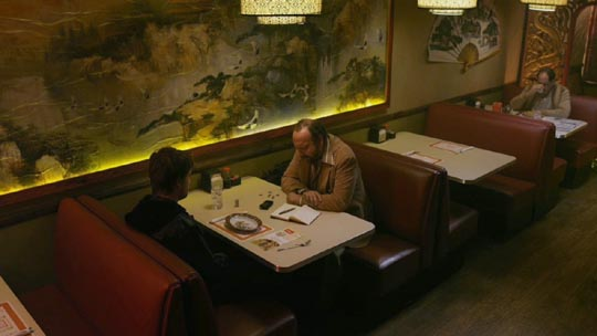 David tells his story to the reporter (Paul Giamatti)