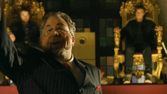 Largeman (Daniel Roeback) welcomes John & David