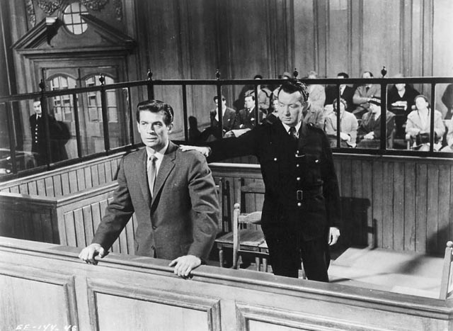 George Nader as Paul Gregory hears the bad news at his trial in Nowhere To Go (1958)