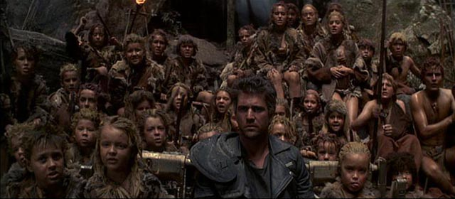 Mad Max promoted to saviour by the tribe of feral children in Mad Max Beyond Thunderdome (1985)