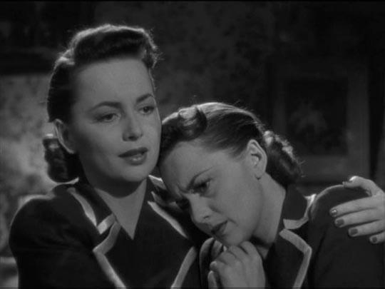 Olivia de Havilland comforts herself