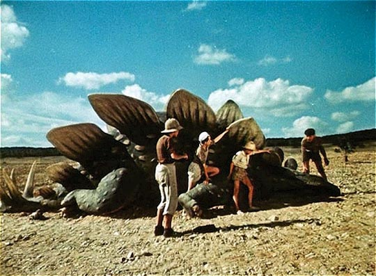 The boys investigate a recently killed Stegosaurus in Karel Zeman's Journey to the Beginning of Time (1955)