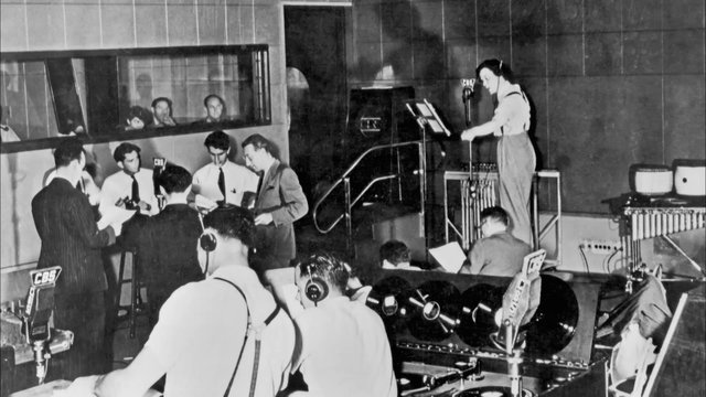 Orson Welles in the CBS studio directing his legendary 1938 production of War of the Worlds