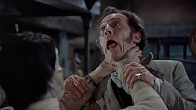 The Creature (Christopher Lee) doesn't appreciate being reanimated by Baron Frankenstein (Peter Cushing) in Hammer's influential Curse of Frankenstein (1957)