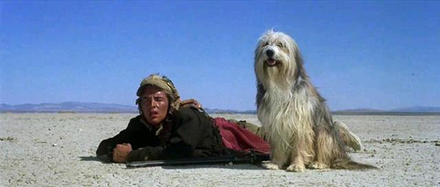 Vic (Don Johnson) and Blood (voice of Tim McIntyre) scout for food in L.Q. Jones' adaptation of A Boy and His Dog (1975)