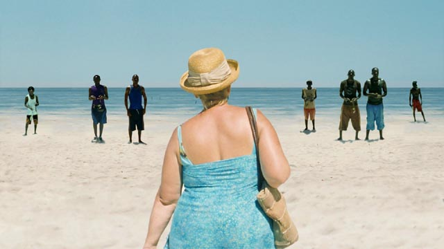 "Teresa (Margarete Tiesel) surveys the young men available to ""sugar mamas"" in Ulrich Seidl's Paradise: Love"