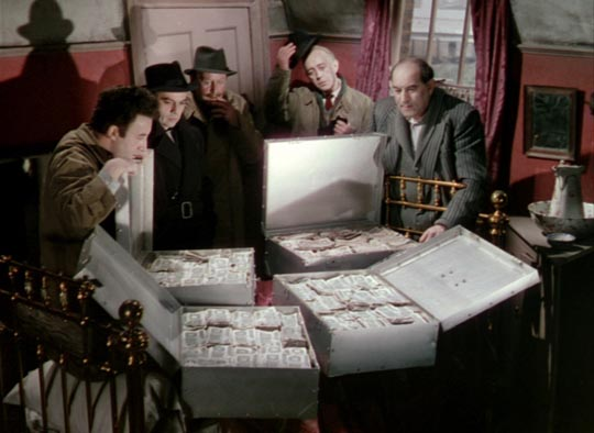 Alec Guinness and his gang contemplate their loot in The Ladykillers
