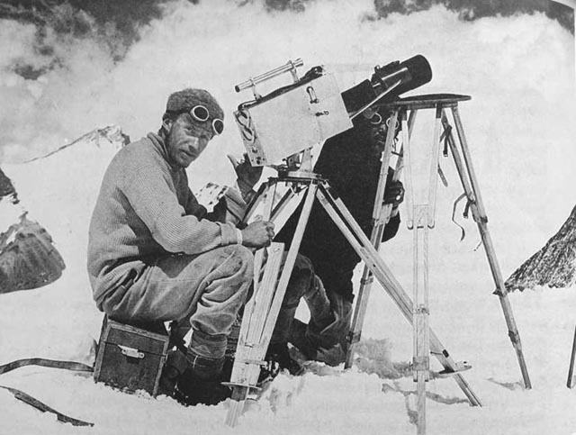 Captain John Noel with his camera and telephoto lens on the slopes of Everest in 1924