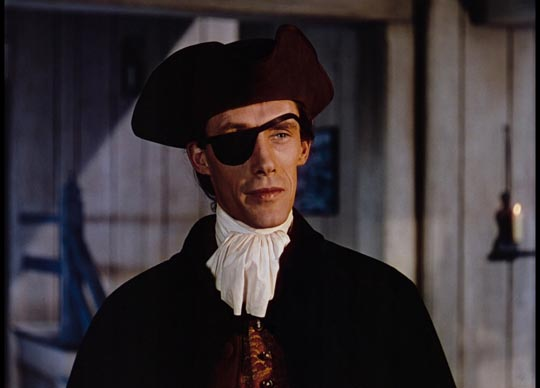 John Carradine as the villain Caldwell
