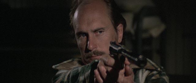 Robert Duvall as the double-crossing partner in Sam Peckinpah's The Killer Elite (1975)
