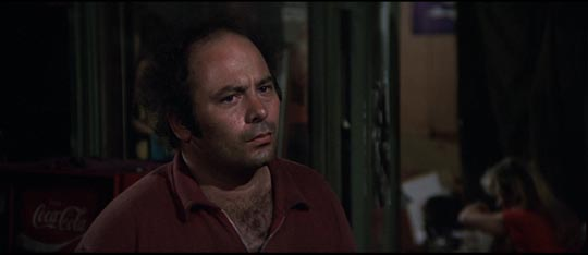 Burt Young as the cabbie