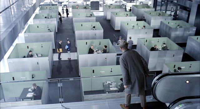 M. Hulot's body tilts across the rigid order od the Modernist office in Jacques Tati's Playtime (1967)