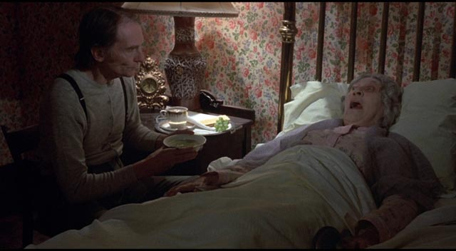 Roberts Blossom as Ezra Cobb, based on famous necrophile killer Ed Gein, in Deranged (1974)