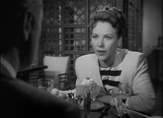 Femme fatale Marjorie Lundeen (Andrea King) proposes a double cross of her lover ...