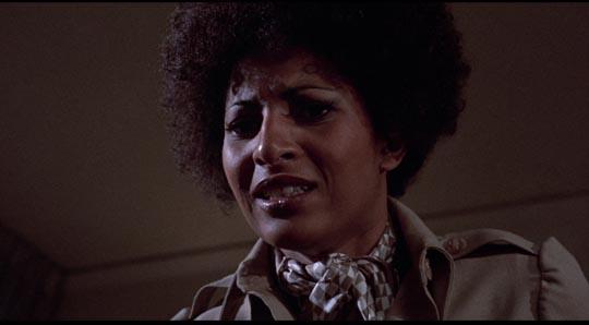 Pam Grier as voodoo priestess Lisa Fortier