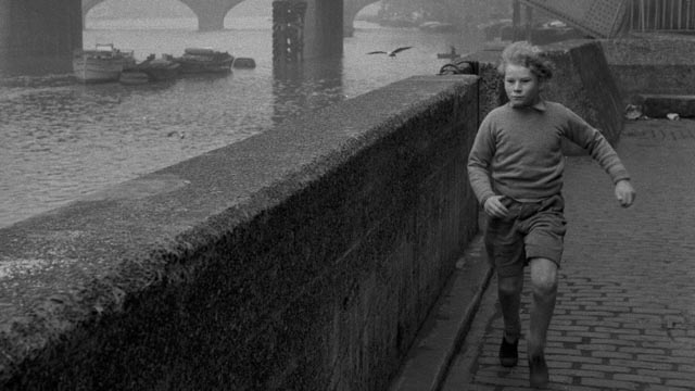Jon Whiteley as frightened runaway Erik on the streets of post-war London in The Weapon (1956)