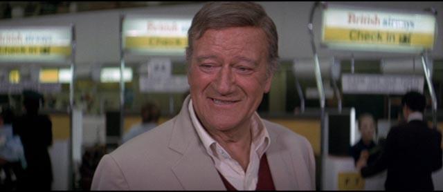 John Wayne as Chicago cop Lt. Brannigan, arriving in England