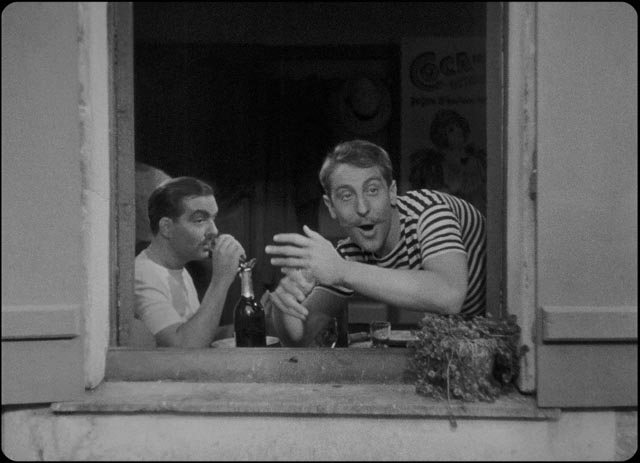 Henri (Georges D'Arnoux) and Rodolphe (Jacques Brunius) spy an opportunity for seduction