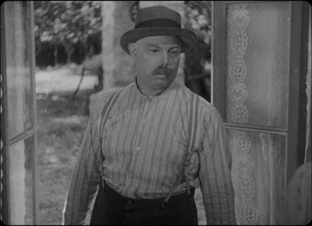 Jean Renoir as the innkeeper Pere Poulain
