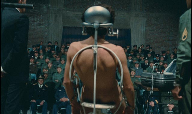 A demonstration of torture techniques using a live subject in State of Siege (1972)