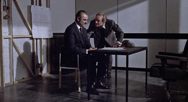The interrogator interrogated: Sgt Johnson (Sean Connery) and Superintendent Cartwright (Trevor Howard)