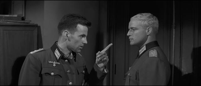Lieutenant Diestl (Marlon Brando) stands up to his superior, Capt. Hardenberg (Maximilian Schell)