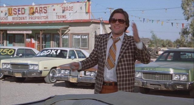 Kurt Russell as the quintessential businessman in Robert Zemeckis' Used Cars (1980)