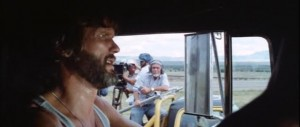 Sam Peckinpah (background) in his cameo as a TV news director in Convoy