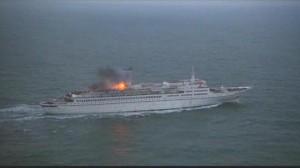 The warning explosion on the liner Britannic in Richard Lester's Juggernaut (1974)