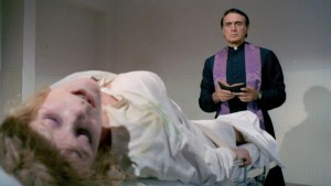 Father Michael (Robert Alda) confronting the possessed Lisa (Elke Sommer) in House of Exorcism (1975)