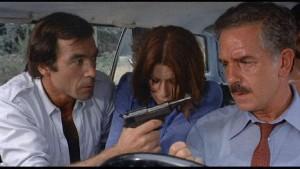 Gang leader Dottore (Maurice Poli), hostage Maria (Lea Lander) and hi-jacked driver Riccardo (Riccardo Cucciolla) in Mario Bava's Rabid Dogs (1974)
