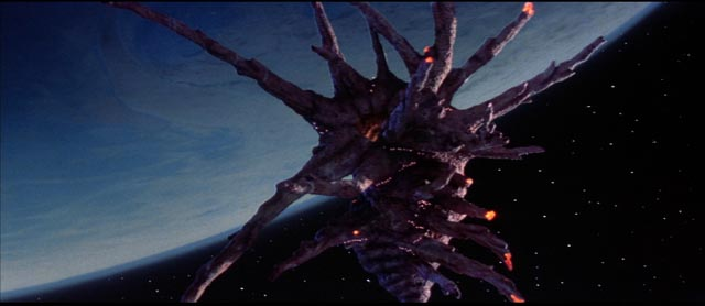 The Black Lectroid spaceship hovering over Earth in W.D. Richter's The Adventures of Buckaroo Banzai Across the 8th Dimension (1984)