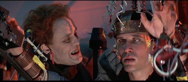 John Lithgow as Dr. Lizardo/Lord John Whorfin tries to pry the secret of the oscillation overthruster from Buckaroo in W.D. Richter's The Adventures of Buckaroo Banzai Across the 8th Dimension (1984)