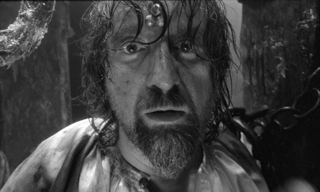 Don Rumata (Leonid Yarmolnik) driven mad by his enforced role of detached observer in Aleksei German's science fiction epic Hard to Be a God (2013)