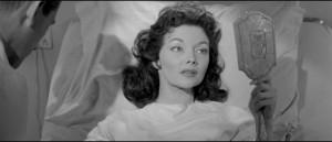 Kyra Zelas (Mari Blanchard) miraculously restored to health by an experimental serum in Kurt Neumann's She Devil (1957)