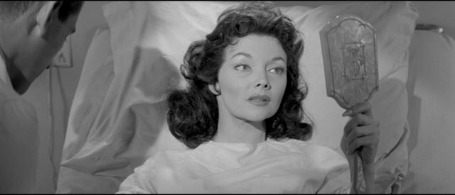 Kyra Zelas (Mari Blanchard) miraculously restored to health by an experimental serum in Kurt Neumann's She Devil (1957)