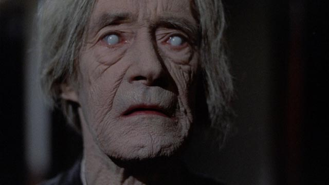 John Carradine as the damned soul guarding the gateway to Hell in Michael Winner's The Sentinel (1977)
