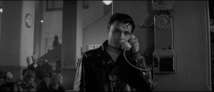 Perry Smith desperately seeking contact before taking the irrevocable step in Richard Brooks' In Cold Blood (1967)