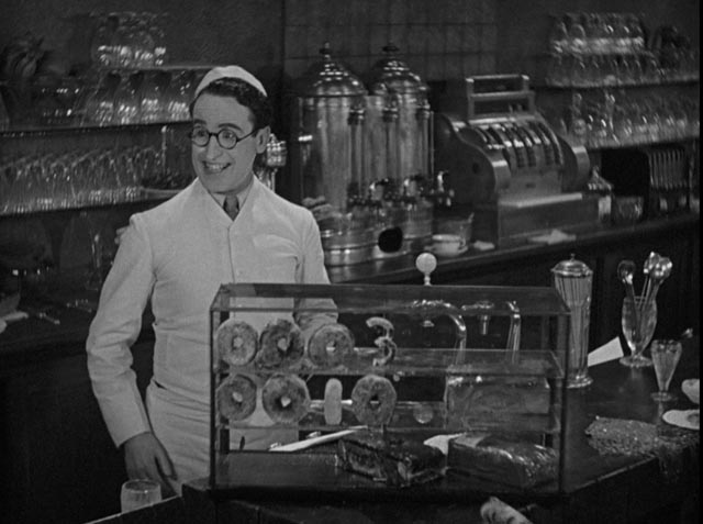 "Harold ""Speedy"" Swift ingeniously passes on the ball score to his co-workers in Speedy (1928)"