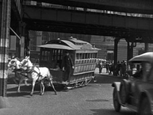 The moment before the crash, a real accident skillfully incorporated into the film's action in Harold Lloyd's Speedy (1928)