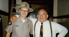 Yes, that's me, the least convincing state trooper ever to appear on screen, hanging out with the very affable Ed Asner on the set of Paul Shapiro's Heads (1994)