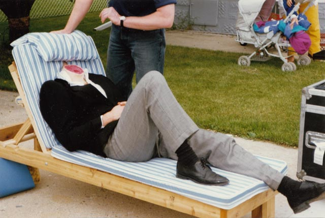One of the victims being prepped for his on-camera moment ... yes, that's a real body; the head is hidden by the cushion on Paul Shapiro's Heads (1994)